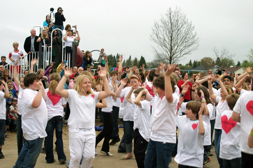 Students from A. J. Charbonneau Public School perform a flash dance
